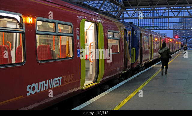 South West train, ready to depart at dusk, London, England,UK - Stock Image
