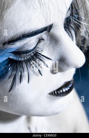 girls face with original make-up - fake eyelashes - Stock Image