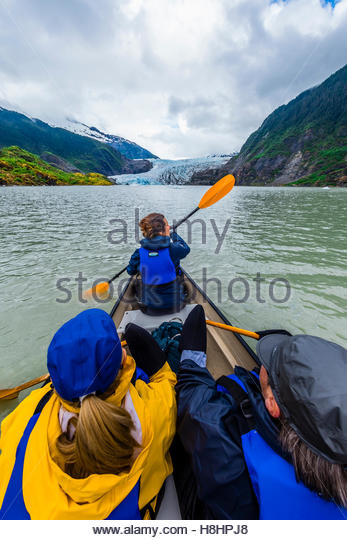 Canoeing on Mendenhall Lake with Mendenhall Glacier in background, Juneau, Alaska USA. - Stock Image