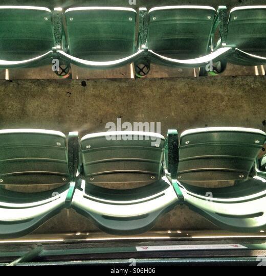 Seats at a baseball stadium - Stock Image