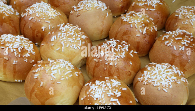 tasty desserts with grains of sugar for sale - Stock Image
