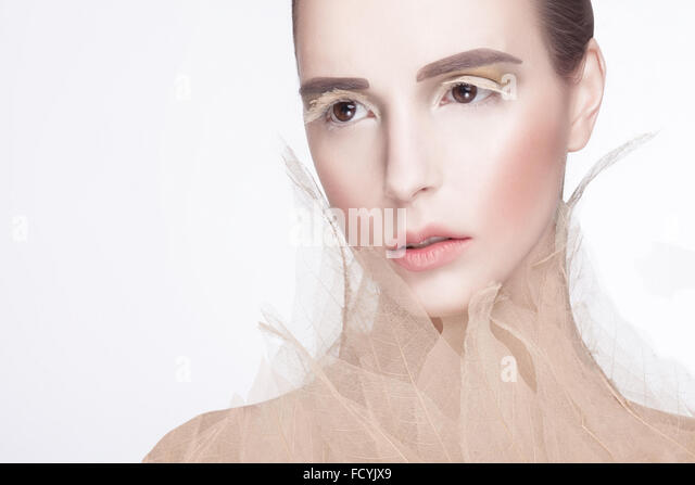 Model posing with skeleton leaves - Stock Image