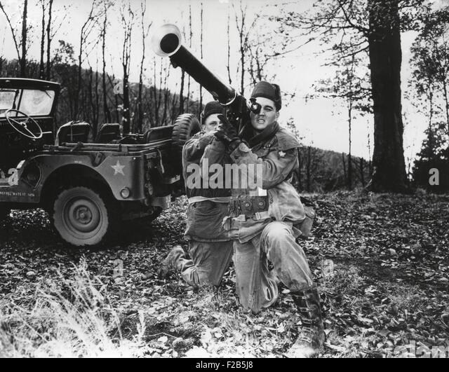 Elvis Presley training with a bazooka while on maneuvers in Germany. He served in Germany from October 1, 1958, - Stock Image