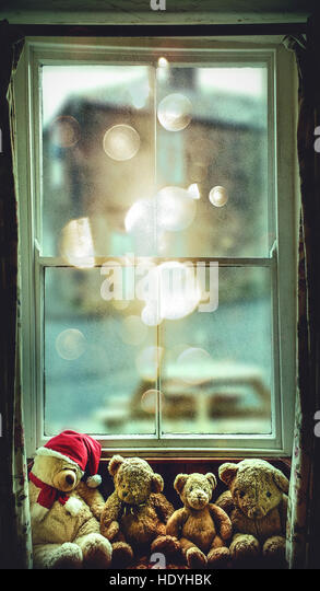 artistic image of window with bears toys on it - Stock Image