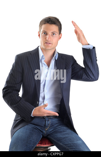 young business man with movements of hands in front of white background - Stock Image