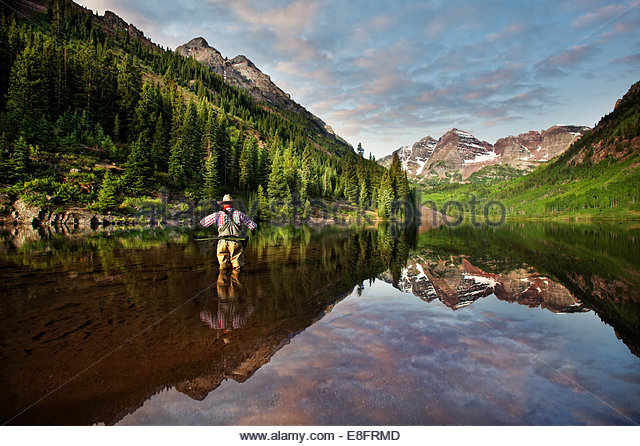 Fly fisherman angling in Maroon Lake, Colorado, America, USA - Stock Image