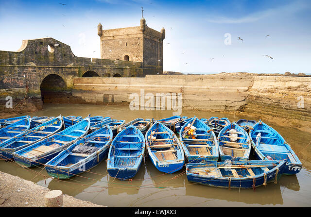 Blue fishing boats in the harbour of Essaouira, Morocco - Stock Image