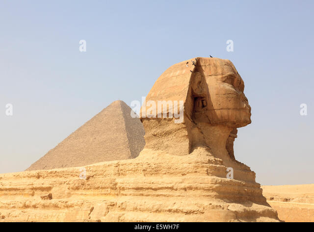 The Sphinx at the Pyramids of Giza in Cairo, Egypt with the Great Pyramid in the background - Stock Image