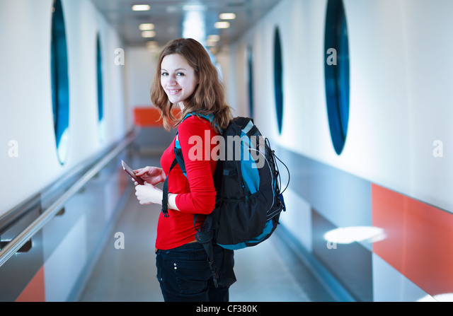 Portrait of a young woman boarding an aircraft - Stock Image