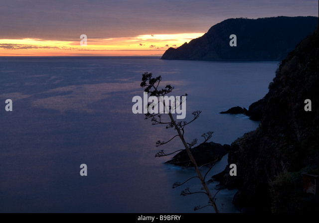 The Ligurian Sea off the coast of Vernazza at dusk on the Cinque Terre in Italy - Stock Image