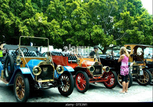 A classy display on a Sunday of vintage cars in Simon's Town's central Jubilee Square - Stock Image