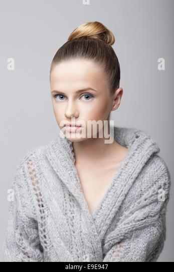 Studio Portrait of Young Female in Gray Woolen Cardigan - Stock Image