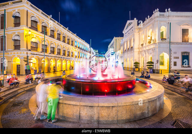 People enjoy Senado Square in Macau, China. - Stock Image