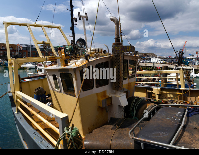 Fishing boat, old harbour, Portsmouth, Hampshire - Stock Image
