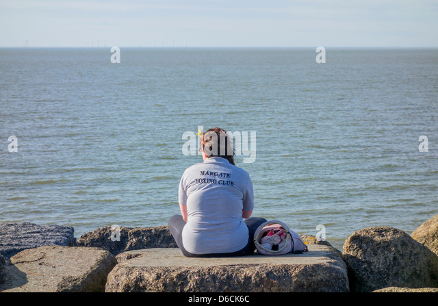 Lone Girl sitting on Beach Margate Boxing Club - Stock Image