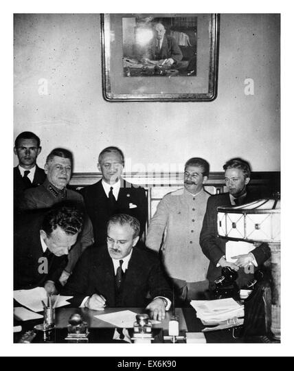 Russian Foreign Minister Vyacheslav Molotov signing the German-Soviet non-aggression pact, Moscow, Russia, 1939. - Stock Image