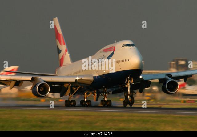 Boeing 747 436 of British Airways touching down at London Heathrow Airport - Stock Image