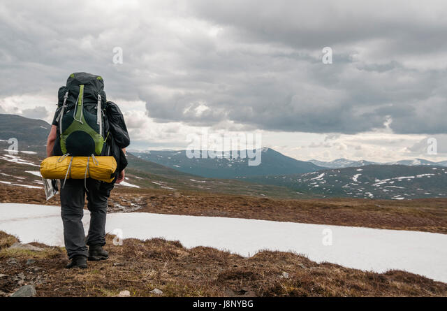 Backpacker walking in mountains - Stock-Bilder