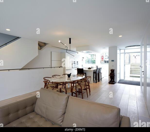 Overall view on ground floor towards entrance. Notting Hill House, London, United Kingdom. Architect: Michaelis - Stock-Bilder