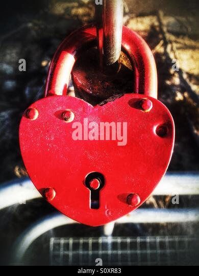 Lock with red heart shape on a bridge - Stock-Bilder