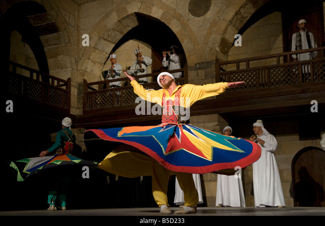 Sufi whirling dervishes performing at the Ghouriyya Mosque in Old Cairo Egypt - Stock Image
