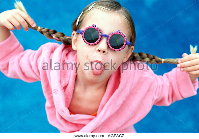 Cheeky girl with sunglasses - Stock Image