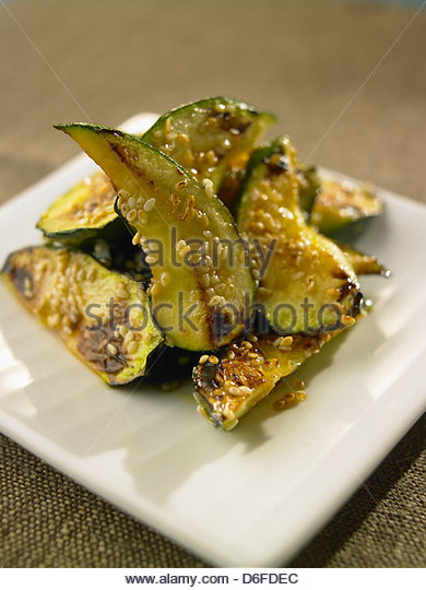 Courgette with sesame seed - Stock Image