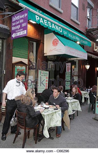 Lower Manhattan New York City NYC NY Little Italy Mulberry Street ethnic neighborhood Paesano Italian restaurant - Stock Image