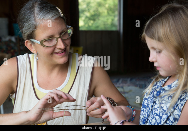 Mother and daughter selecting dried herbs - Stock Image
