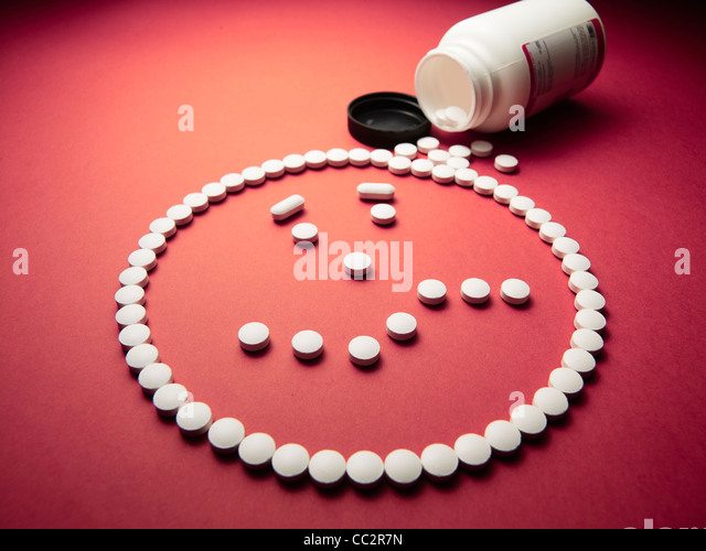 drugged face made out of pills and drugs - Stock Image