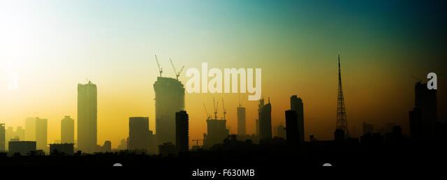 Mumbai's changing skyline during sunrise. - Stock Image
