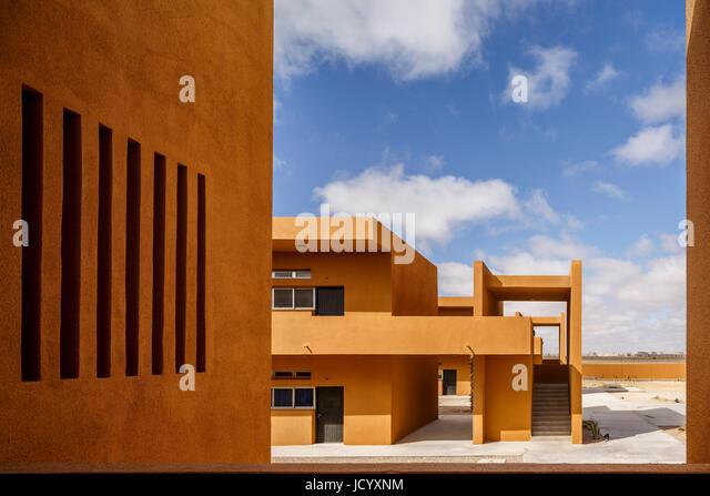 Exterior facades. Laayoune Technology School, Laayoune, Morocco. Architect: Saad El Kabbaj, Driss Kettani, Mohamed - Stock-Bilder