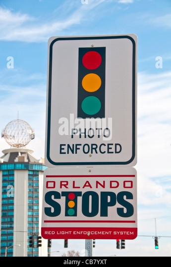 Traffic sign photo enforced red light full stop International Drive Orlando FL - Stock Image