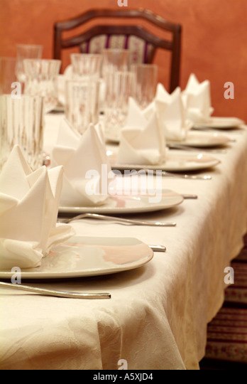 Place Settings on a Dining Table for a Dinner Party - Stock Image