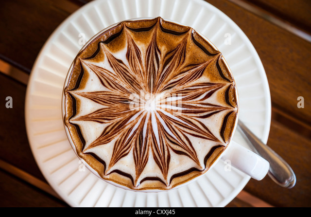 Artistically decorated cappuccino, cup from above - Stock-Bilder