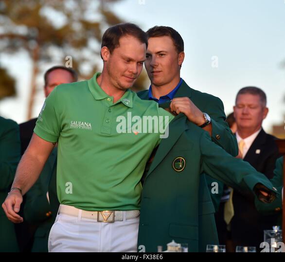 Augusta, Ga, USA. 10th Apr, 2016. Masters champion Danny Willett gets the Green Jacket from Jordan Spieth following - Stock Image