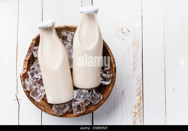 Milk in bottles on ice - Stock Image
