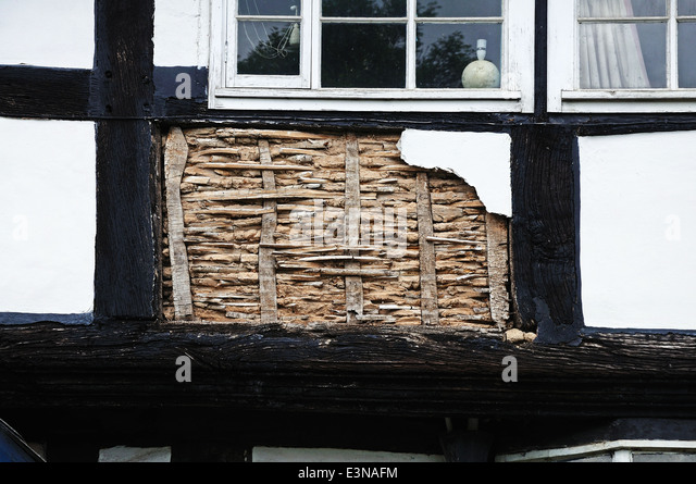 Small panel of wattle and daub being restored on a traditional white timbered building, Pembridge, England, UK. - Stock Image