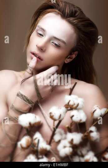 Glamor. Trendy Brown Hair Guy with Bouquet of Flowers - Stock Image
