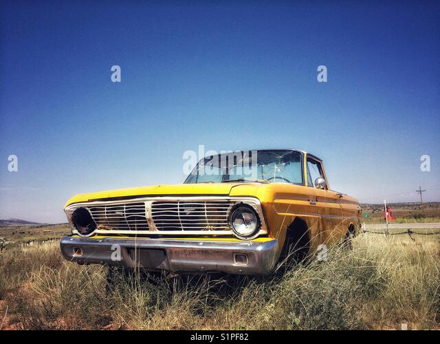 Old and rusty Ford car on route 66, California, USA - Stock Image