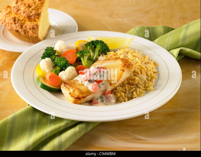 Cod dinner with vegetables and rice - Stock Image