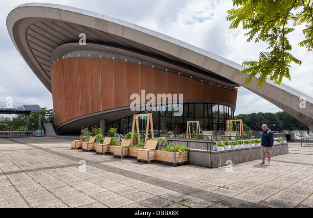 Man at Herb and vegetable garden in reclaimed packing crate wood at HKW Concert hall and exhibition centre, Tiergarten, - Stock-Bilder