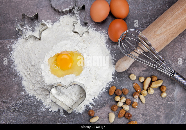 raw ingredients for preparing a dough for cookies - Stock Image
