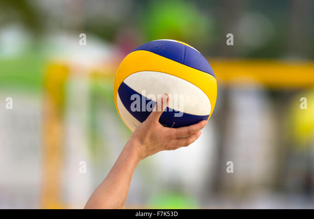 Volleyball is a volleyball being held up by a volleyball player ready to be served. - Stock-Bilder