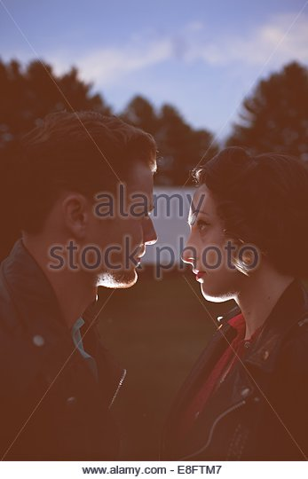Young couple face to face outdoors - Stock-Bilder