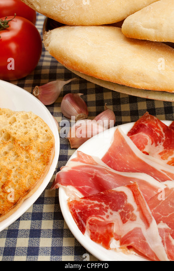 Typical breakfast mollete with ham tomato and oil Antequera Malaga Andalusia Spain - Stock Image
