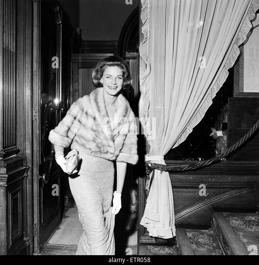 Guests attending a party held by Laurence Olivier and Lauren Bacall. 10th November 1958. - Stock Image