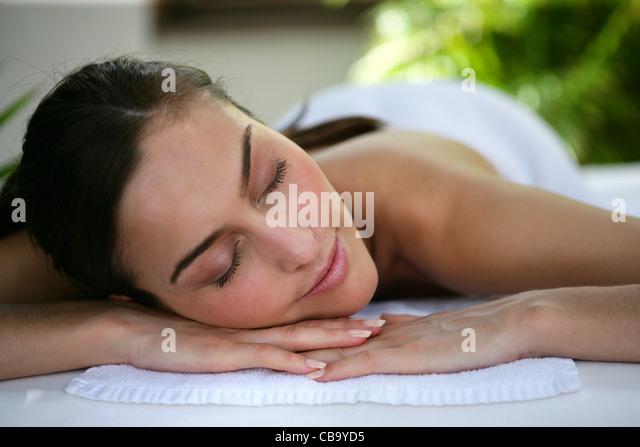 Woman laying down at health spa - Stock Image