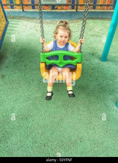 Toddler on the swing - Stock Image