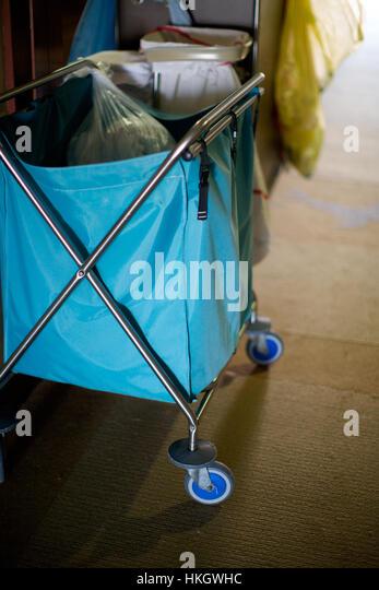 laundry cart. blue, wheeled, basket, laundry. - Stock Image